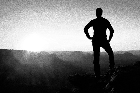 dashed: Black and white dashed retro sketch. A man has his hands on  hips. Sportsman  silhouette in nature within  daybreak.
