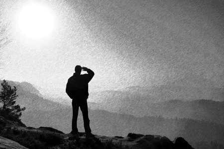 empires: Black and white dashed retro sketch.  Slim tourist on the cliff of rock in rock empires park  is watching over the misty and foggy morning valley to Sun Stock Photo