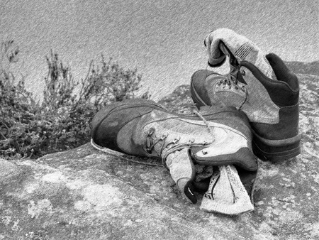 sweaty: Black and white dashed retro sketch. Hiker high boots and sweaty grey socks. Resting on the boulder at the nice mountain stream Stock Photo