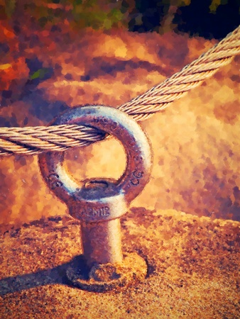 wick: Watercolor paint. Paint effect.Detail of steel anchor bolt eye in sandstone rock. The end of the wick steel rope. Climbers path via ferrata. Iron twisted rope fixed in the block.