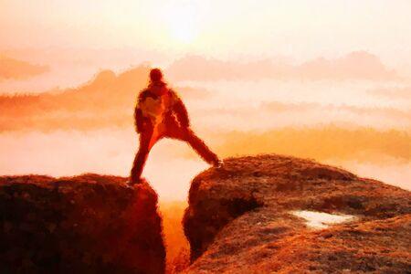 Watercolor paint effect. Man jumps Between peaks of mountain above valley Reklamní fotografie