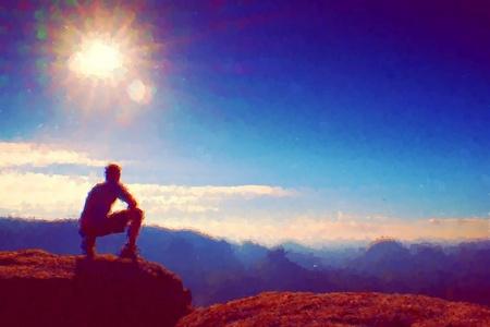 rocky peak: Watercolor paint. Paint effect.Hiker in black sit on the rocky peak. Wonderful daybreak in mountains, heavy mist in deep valley. Man sit on the rock. Stock Photo