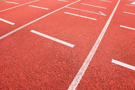 start line: Start line. Red running racetrack on the outdoor athletic stadium