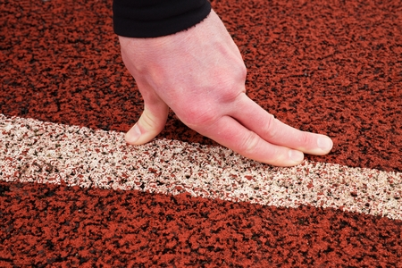 pers: Bended fingers on start line, detailed  red rubber retrack Stock Photo