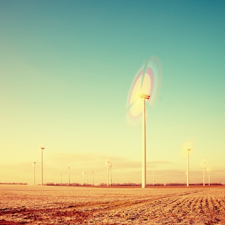 suny: Modern Wind Turbines Producing Energy in suny spring morning. Vintage Style Toned effect