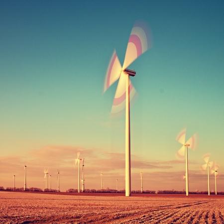 industry moody: wind turbine on sunrise