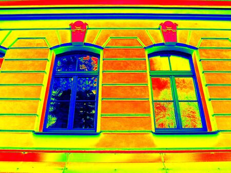 gamma radiation: Thermography scan. Traditional construction of bricks house with old style windows. Thermal waste map. Just effect. Stock Photo