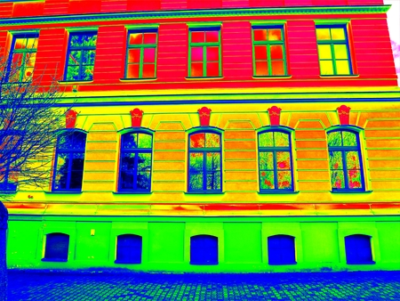 Thermography scan. Traditional construction of bricks house with old style windows. Thermal waste map. Just effect. Фото со стока