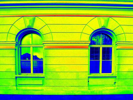 thermography: Thermography scan. Traditional construction of bricks house with old style windows. Thermal waste map. Just effect. Stock Photo