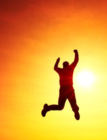 flying man: Flying man. Young man falling down on colorful sky background.