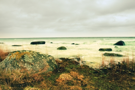 ebb: The misty seascape within ebb. Cold spring weather