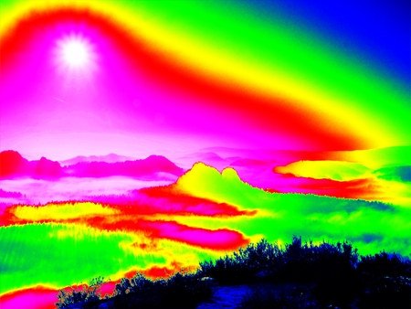 thermography: Amazing thermography photo of hilly landscape. Spring hot sunset above long misty valley with forest. Stock Photo