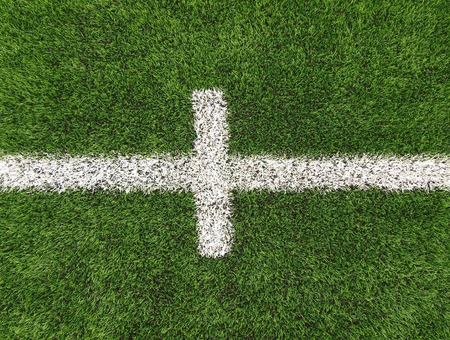 heated: White line on Heated winter football field with plastic grass