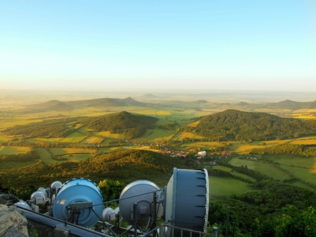 meteorological: View from tower of meteorological observatory with many parabolic satellites this morning countryside. Spring morning on the peak of hill.