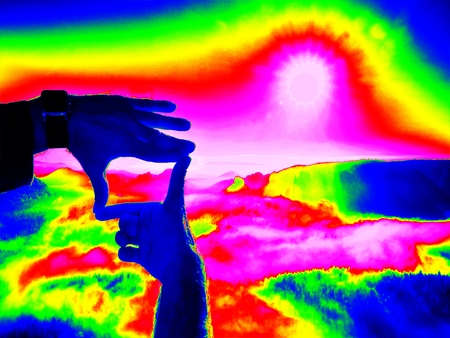 thermogram: Thermography measurement, changed colors of ultra violet light. Tourist hand makes photo frame and watching into misty Spring Valley.