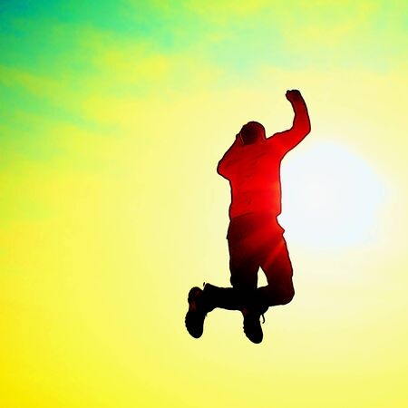 flying man: Cartoon of photo. Flying man. Young man falling down on colorful sky background. Stock Photo