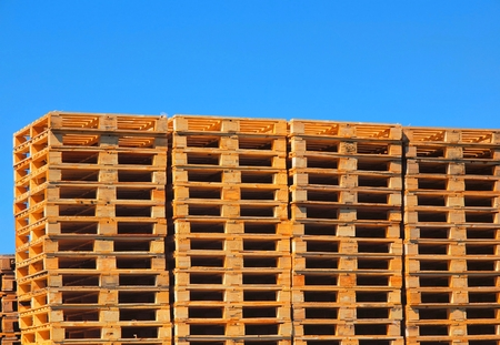 transportation company: New wooden euro pallets stocked outside at transportation company, stored pallets
