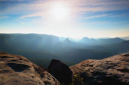 increased: Amazing  daybreak in Saxony Switzerland park. Sandstone peaks increased from foggy background Stock Photo