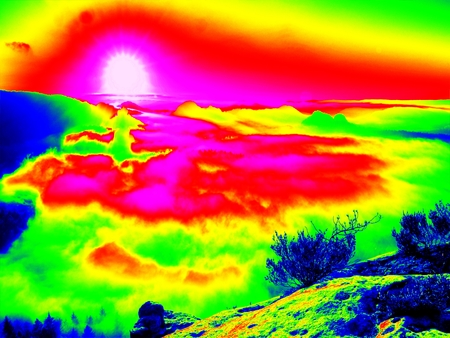 thermography: Amazing thermography photo of hilly landscape. Autumn sunset above long deep valley with forest. Stock Photo