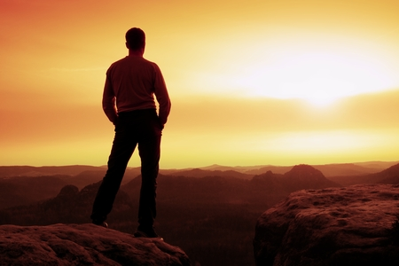 powerful man: Silhouette of Young Confident and Powerful Man Standing with Hands on Hips, Late Day Sun with Copy Space Stock Photo