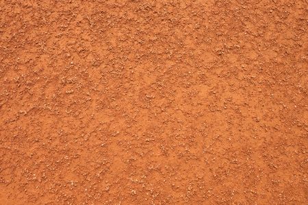 end of the trail: Dry light red crushed bricks surface on outdoor tennis ground. Detail of rough texture