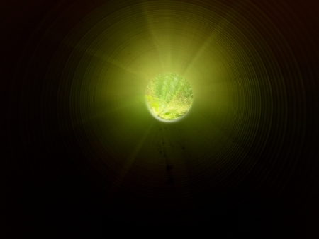 under ground: View inside of long plastic tube under ground. Colorful ribbed wall of plastic pipe, green light at circle end. Tunnel under ground with far light Stock Photo