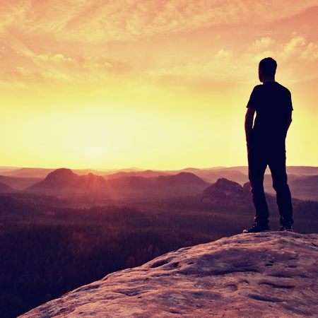 powerful man: Silhouette of Confident and Powerful Man Standing with Hands on Hips, Late Day Sun with Copy Space