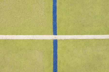 worn out: Worn out plastic hairy carpet on outside hanball court. Floor of sports playground with colorful marking lines. Stock Photo
