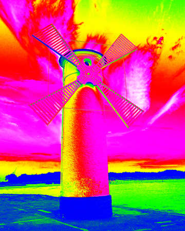 infra: Infra scan, thermography photo. White old lighthouse decorated as windmill by sea on rocky coast. Seascape and landscape