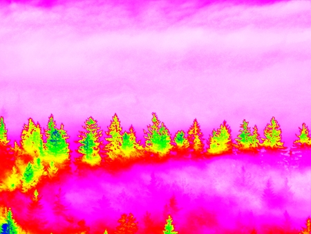 infra: Infra scan, thermography photo. Mist in forest mountains. Fantastic dreamy sunrise on rocky mountains with view down to foggy misty valley below Stock Photo