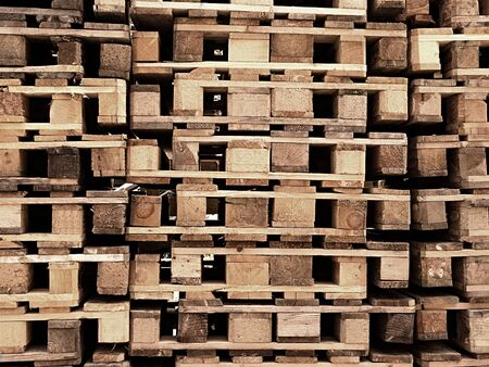 euro pallet: Outside stock of old manufactured wooden standard euro pallets stored in pylons