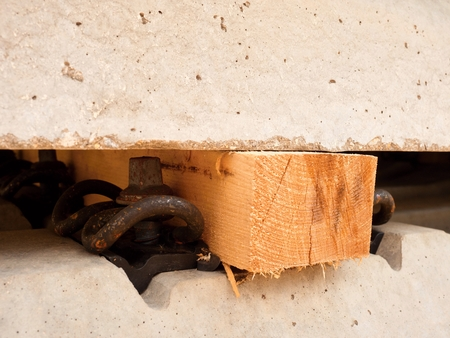 sleepers: Wooden beam as separator for safety manipulation by forklift.  Concrete railway ties stored for reconstruction of old railway station.