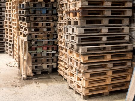 skidding: Wooden shipping pallets with sky background