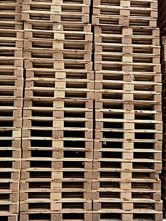 breaking up: Stock Piles of wooden pallets in a yard ready for breaking up and recycling into firewood or kindling