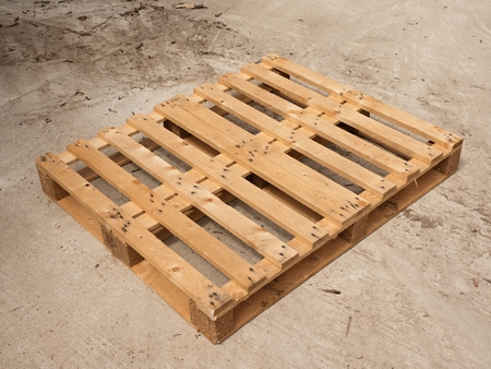 worn out: Wooden pallet on worn out concrete ground. Empty pallet ready for packing and shipping