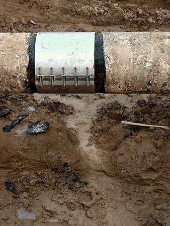 repaired: Old big drink water pipes joined with stainless repairing sleeve members. Finished repaired piping waiting for covering the clay. Asphalt isolation.