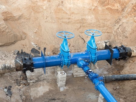 ductile: 500 mm drink water pipes joined with new Blue Gate valves and new black Waga multi joint members. Finished repaired piping waiting for covering the clay. Asphalt isolation.