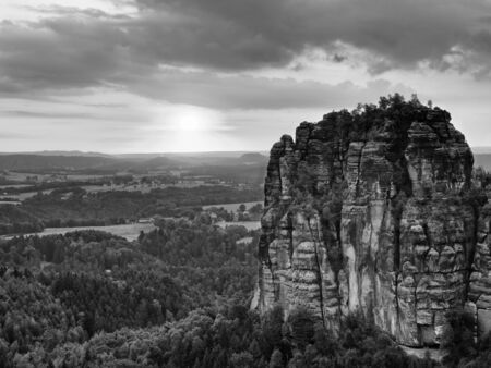 increased: Autumn evening view over sandstone rocks that fall valley of Saxony Switzerland. Sandstone peaks and hills Increased from colorful background. Stock Photo