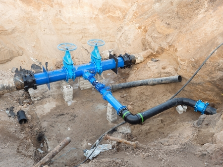 repaired: 500 mm drink water pipes joined with new Blue Gate valves and new black Waga multi joint members. Finished repaired piping waiting for covering the clay. Asphalt isolation.