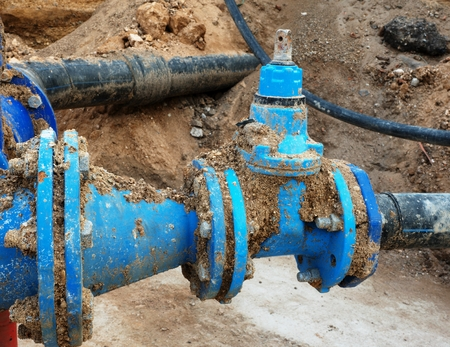 ductile: Detail of fittings, 250mm and 150mm gate valves, reduction joint members in drink water system. Repairing of piping in excavation pit. Extreme kind of corrosion, metal corroded texture. Stock Photo