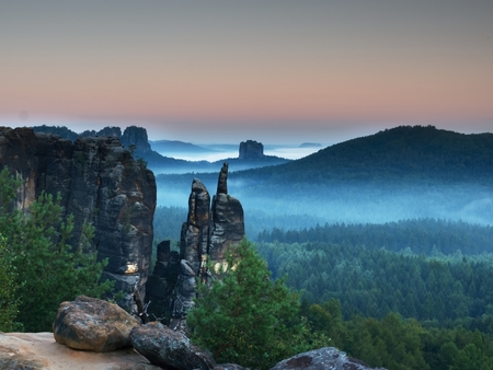 Autumn evening panorama view over sandstone rocks that fall valley of Saxony Switzerland. Sandstone peaks and hills Increased from colorful background.