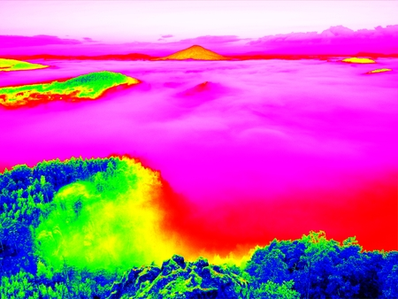 Amazing photo thermography. Spring misty landscape. Morning in beautiful hills of natural park.