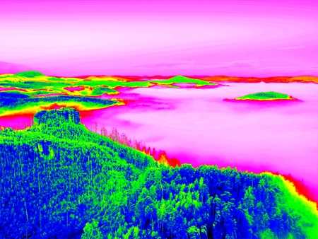 invisible: Amazing photo thermography. Spring misty landscape. Morning in beautiful hills of natural park.