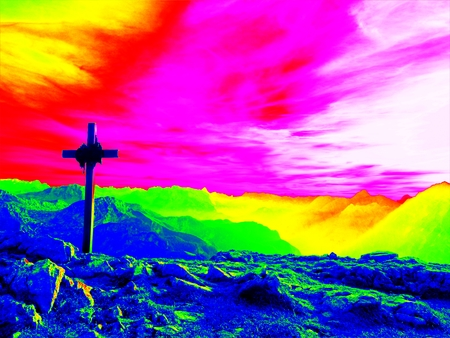 Amazing photo thermography. Big wooden cross at mountain peak in wind with Buddhist praying flags. Cross on top Stock Photo