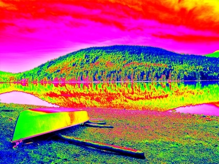thermography: Amazing thermography photo. Abandoned fishing paddle boat on bank of Alps lake. Morning lake glowing by sunlight. Dramatic and picturesque scene.