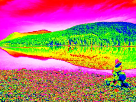 thermography: Amazing thermography photo. Balanced stone pyramid on shore of blue water of mountain lake. Stock Photo