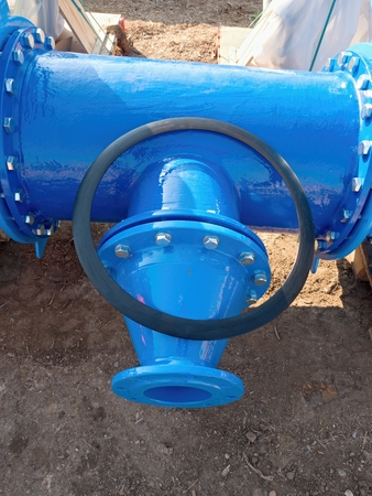sealing ring: 500mm  drink water pipe  joint with reduction member to 150 mm unit by screws and nuts. Pipe fitting, rubber plastic sealing ring. Piping repair, fasteners and spare parts . Stock Photo