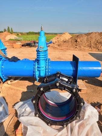 500mm new black waga multi joint unit. 500 mm drink water Gate valve joint with screws and nuts to pipe fitting. Piping repair, unit on wooden pallet.  Drink water pipeline.