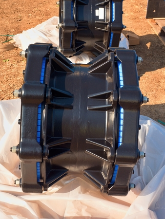 drilled: 500 mm black Waga new multi joint members. New spare parts for repairing of piping in paper cover. Drink water pipeline. Stock Photo
