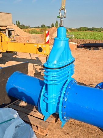 500mm big new drink water Gate valve joint with screws and nuts to pipe fitting. Piping repair, unit on wooden pallet, fasteners and spare parts .